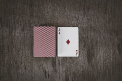 Ace of diamonds. playing cards on a wooden background. Risk and Gambling background. Game abstract and concept photo. space for text Stock Photography