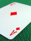Ace of Diamonds Shallow. Ace of diamonds on a green felt table top Stock Photo