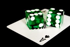 Ace and dice on black Royalty Free Stock Photography
