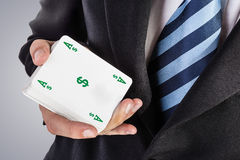 Ace of dollars. An elegant young businessman showing an ace in his hand Stock Photos