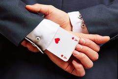 Ace em sua luva na parte traseira Imagem de Stock Royalty Free
