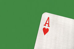 Ace on the green table. Ace of hearts on the green table Stock Photos