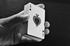 Ace. Hand holding deck of cards showing ace at the bottom Stock Images