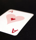 Ace of hearts. Lonely ace of hearts playing card on a black background Stock Image