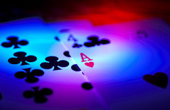 Ace of Hearts. Playing cards with focus on the Ace of Hearts under colored lights Royalty Free Stock Images