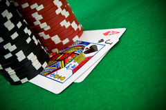 Ace of hearts and black jack with poker chips Royalty Free Stock Image