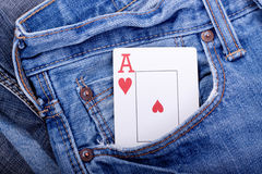 Ace of hearts in blue jeans pocket Royalty Free Stock Photo