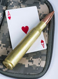 Ace of hearts and bullets. Stock Images