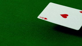 Ace of hearts falling on casino table. In slow motion stock video