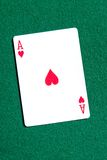 Ace of hearts playing card on the table Stock Image