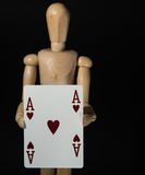 Ace of hearts. Wooden dummy with the ace of hearts playing card Royalty Free Stock Image