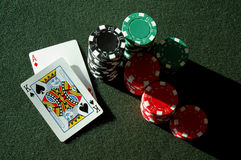 Ace King - Big Slick. Big Slick (ace king) on a poker table with stacks of chips royalty free stock photos