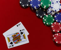 Ace king with chips. Poker hand ace king with chips on red felt Stock Image