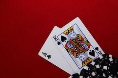 Ace king with chips. Poker hand ace king with chips on red felt Royalty Free Stock Photography