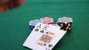 Ace and King placed on chips. This is a video of an Ace and a King being placed on a pile of poker chips stock footage