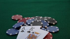 Ace and King placed on pile of poker chips. stock video footage