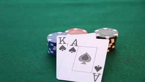Ace and King placed on poker chips. This is a video fo an ace and king placed on stacks of poker chips stock footage