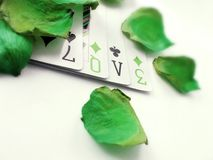 Ace of Love. Conceptual photography with four cards spelling love stock photos