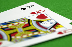 Ace and the Queen. Close-up of a Ace of Spades & Queen of Hearts Royalty Free Stock Photos