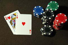 Ace Queen of Hearts. And poker chips on a table Royalty Free Stock Image