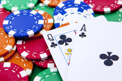 Ace and queen with poker chips in background. Stock Images