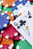 Ace and queen with poker chips in background. Stock Photography