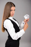Ace In Sleeve. Business woman with playing cards hidden under sleeve. Gray background Royalty Free Stock Image