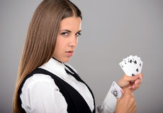 Ace In Sleeve. Business woman with playing cards hidden under sleeve. Gray background Royalty Free Stock Photos