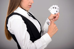 Ace In Sleeve. Business woman with playing cards hidden under sleeve. Gray background Stock Photography