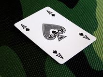 Ace spade. On the camouflage pattern, concepts: game, poker, hidden card, cheat at cards, war game stock photo