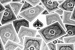 Ace of spades. Hidden between black and grey playing cards Stock Photos