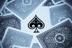 Ace of spades. Hidden between other playing cards in selenium tone Stock Photos