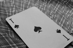 Ace of spades on back of playing cards black and white as gambling background. Stock Photos