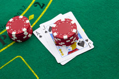 Ace of spades and black jack. With red poker chips in the background Royalty Free Stock Images