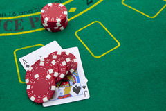 Ace of spades and black jack. With red poker chips in the background Royalty Free Stock Image