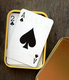 Ace of spades in box on wooden table background Stock Photography