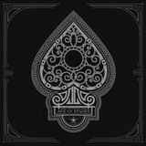 Ace of spades with forging curl pattern inside. White on black Stock Images