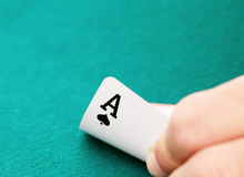 Ace of spades in hand. Ace card with limited depth of field, focus on the symbol Royalty Free Stock Photos