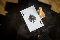 Ace of spades standing above the rest of a normal deck stock photo
