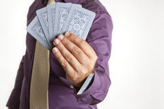 An ace up its sleeve. A man playing a poker game with an ace up his sleeve stock images