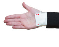 Ace Up The Sleeve. Woman hand with ace up the sleeve Royalty Free Stock Images