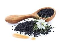 Aceite de comino negro con la flor Imagen de archivo libre de regalías