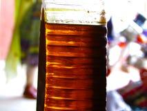 Aceite de coquefacción en botella imágenes de archivo libres de regalías