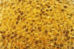 Aceite de hígado de bacalao amarillo Fotos de archivo libres de regalías