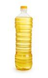 Aceite de la verdura o de girasol en la botella plástica aislada Imagenes de archivo