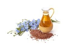 Aceite de linaza con las semillas de lino Fotografía de archivo