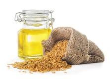 Aceite de linaza y semillas de lino de oro Fotos de archivo