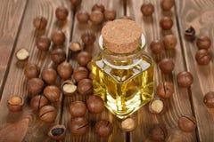 Aceite de nuez de macadamia fotografía de archivo