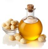 Aceite de nuez de macadamia imagen de archivo
