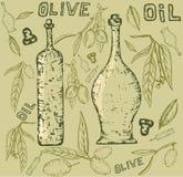 Aceite de oliva con las botellas Foto de archivo libre de regalías